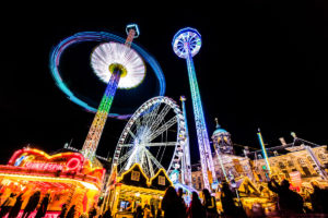 Amusement fair rides all light up at night